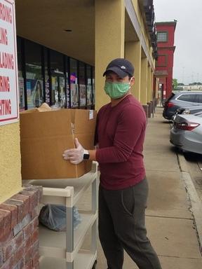 Amram delivering food boxes.jpg